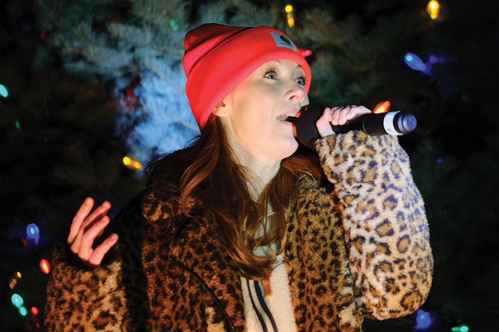Erin West singing at celebration